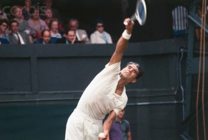 26 Jun 1969, London, England, UK --- Original caption: Wimbledon, England: Pancho Gonzales of the U.S. in action during his Wimbledon tennis open match against Ove Bengsson of Sweden. He won this Men's Singles event, 6-4, 6-3 and 6-3. --- Image by © Bettmann/CORBIS
